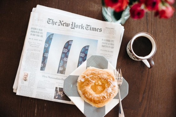 New York Times newspaper with donut