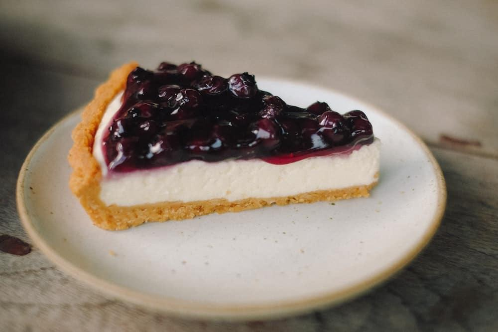 Blueberry cheesecake on ceramic plate