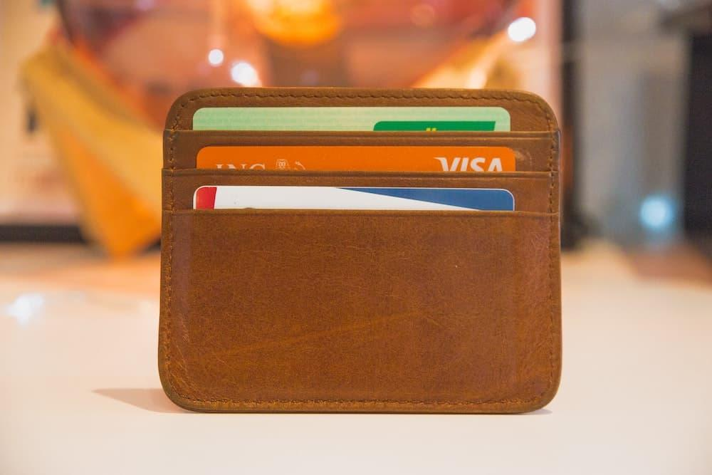 credit cards in brown leather wallet